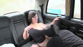 organic busty woman gives footjob in taxi cab