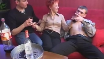 Within a event a redheaded MILF represents four males directly