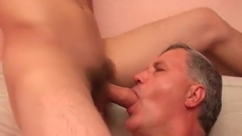 Old stud twiddling with youngster cocks