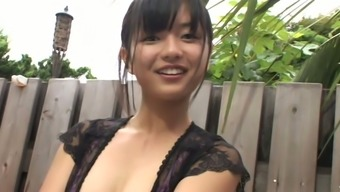 Raven haired Asian beauty Mayumi Yamanaka enjoys webcam while you're in the shower