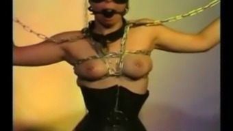 Heavy pierced slave with strecthers on her pierced pussy