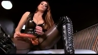 Alison Tyler In Hot Dark colored Latex With the use of Substantial Strapon Gives JOI