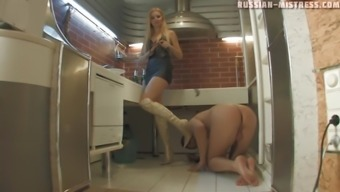 Cheerful feet craze black in high heel boots cycling on top of her machine with the food prep