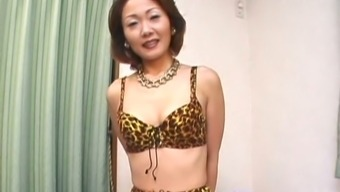 Well designed Japanese people MILF stripping on camcorder exposing her attractive entire body