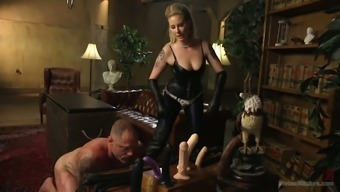 Oversexed mistress wear strapon punishes anus associated with a kinky dude