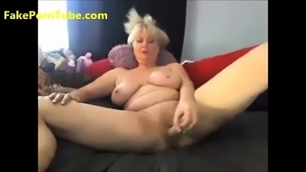 Horny busty granny having fun with the use of large excess weight dildo on camera