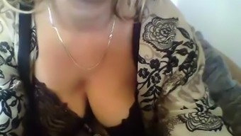 Beautiful blonde milf shows her natural juicy tits