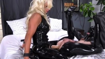 Latex pegging mistress