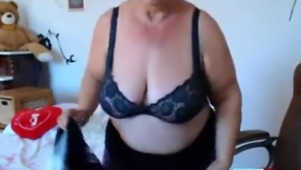 Granny twiddling with great boobs on web camera!