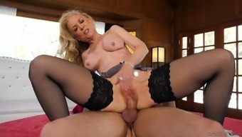 Beautiful dame Nina Hartley gets to drive an extended penis toward the floor