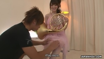 While they played The french language horn Kanako Iioka gets her soppy pussy teased