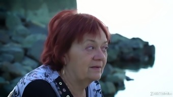 Red haired granny Marsha is dreaming of her young lover