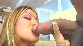Tattooed Asian doll coping up with big black cock in interracial sex
