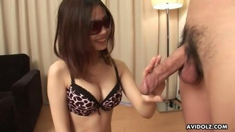 Japanese chick Rena likes to wear sunglasses while giving oral sex