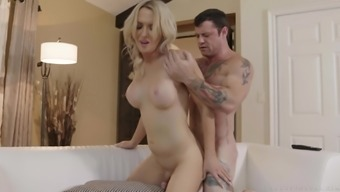 Blonde busty shemale Kayleigh Coxx strokes her tiny cock while fucked