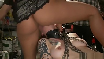 Blonde sub is fisted in bikers club