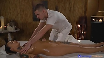 Inked beauty Adel Asanty is covered in oil during rough massage sex