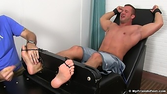 Muscular man moans while an old pervert tickles his whole body