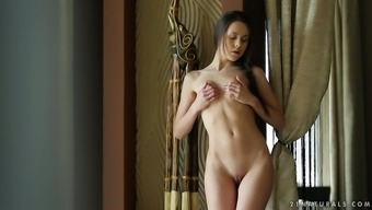 Fantastically beautiful Ukraine youngster fondling her pussy on camera