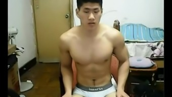 Strapping Eastern male model leaves base his clothing and jerks off his penis on camera.