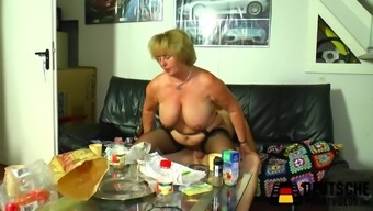 Brown granny with large titties taking pleasure in a wild penis trip