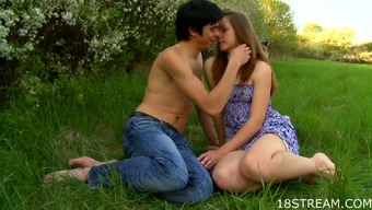 Erotic teenager lovemaking within the grassland