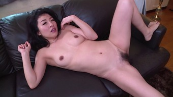 Attractive Oriental homemaker gets her hirsuite pussy drilled with the cooking