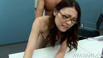 Hard rectum in business office for from asia young adult by using eye-glasses