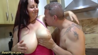 Severe large genuine breast plus-size woman MILF likes throat gagging and gives a warm footjob