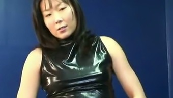 Horny Organic MILF in latex ensemble fidgeting with her pussy