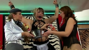 Femdom lesbian threesome with the use of chained blonde