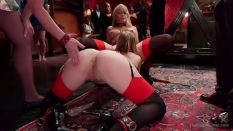 Tied up whores are fucked by one kinky dude in public