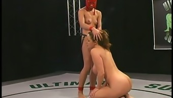 Warm chicken in scarlet mask pounds Christina Hauler within the diamond engagement ring