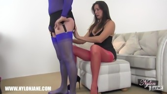 Gimp person who serves worships MILFs sexy pvc blanketed feet and legs