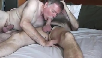 Two sexy, hunky, hung daddy bears kissing, licking, sucking and ending in a hot 69.